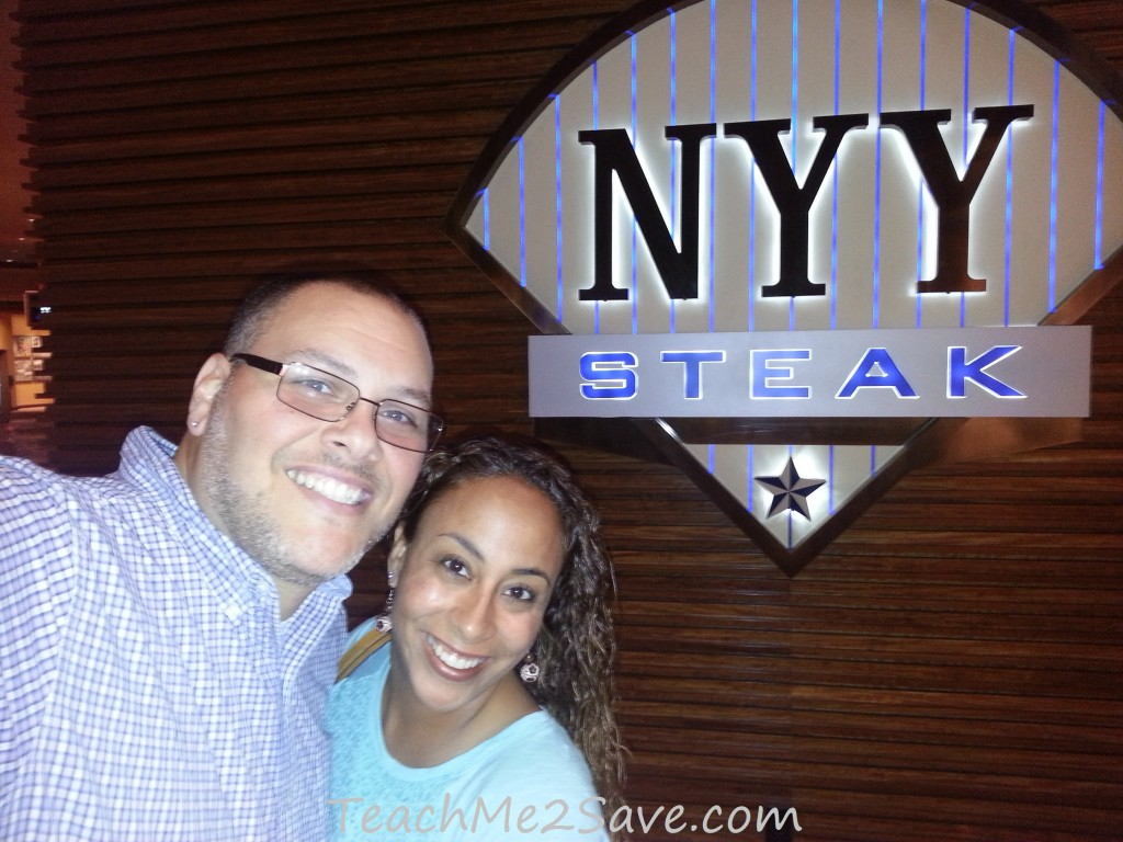 Pic in front of NYY Steak Sign