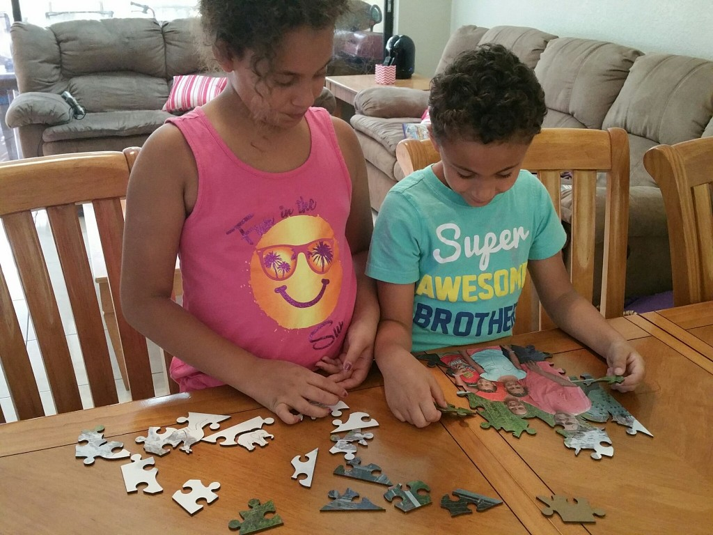 Kids putting together a Wentworth Wooden Puzzle