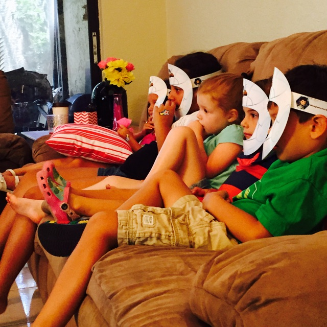 Watching Disney Junior Miles from Tomorrowland with helmets