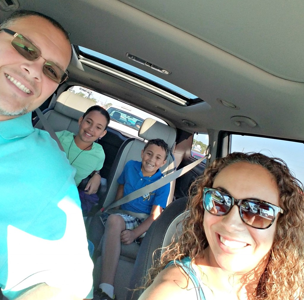 Fernandez Family Driving the Kia Sedona