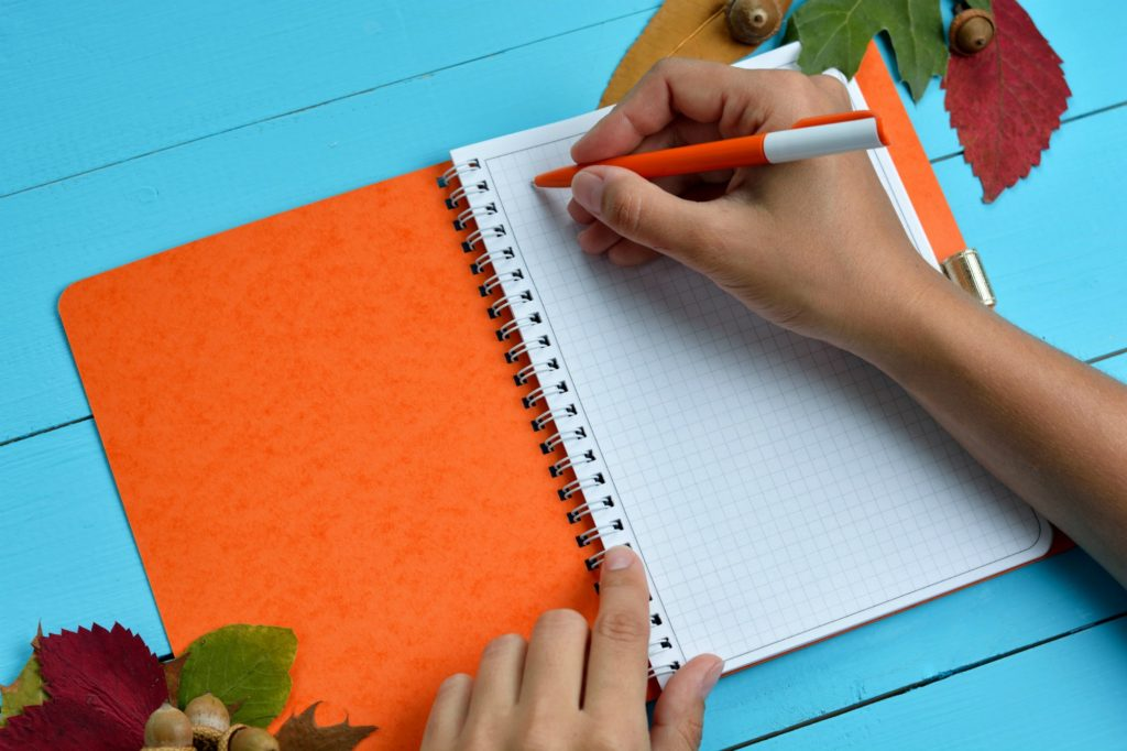 Kid writing in a journal