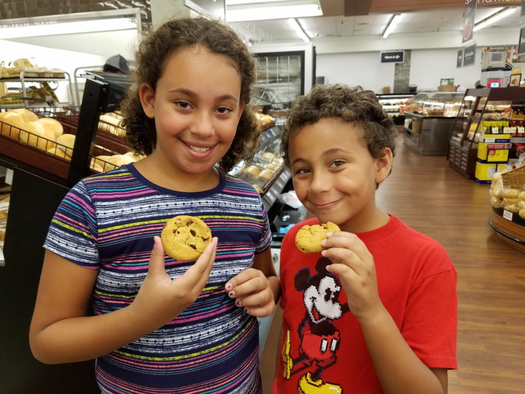Kids eating Safeway Stores Cookie