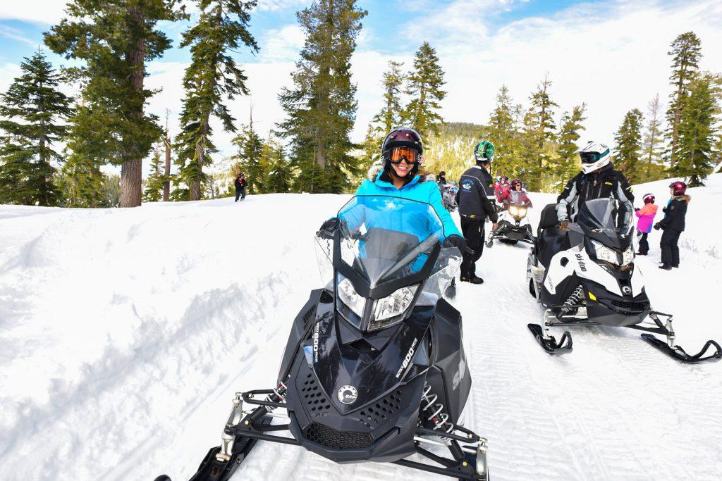 Leanette Fernandez on snow mobile