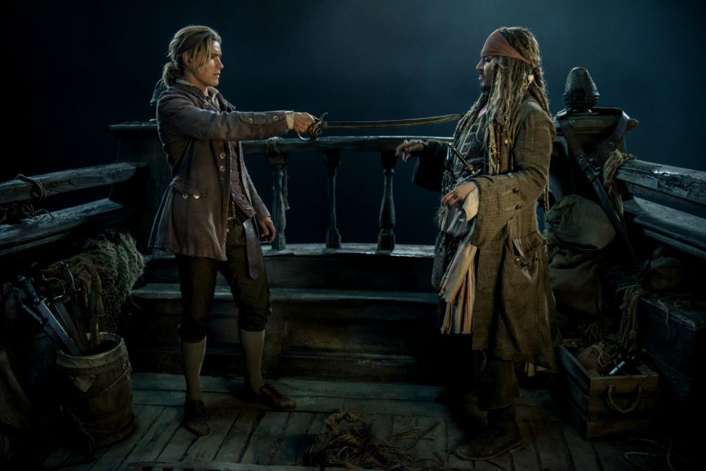 """PIRATES OF THE CARIBBEAN: DEAD MEN TELL NO TALES"" The villainous Captain Salazar (Javier Bardem) pursues Jack Sparrow (Johnny Depp) as he searches for the trident used by Poseidon Pictured L-R: Brenton Thwaites (Henry) and Johnny Depp (Captain Jack Sparrow) Ph: Peter Mountain © Disney Enterprises, Inc. All Rights Reserved."