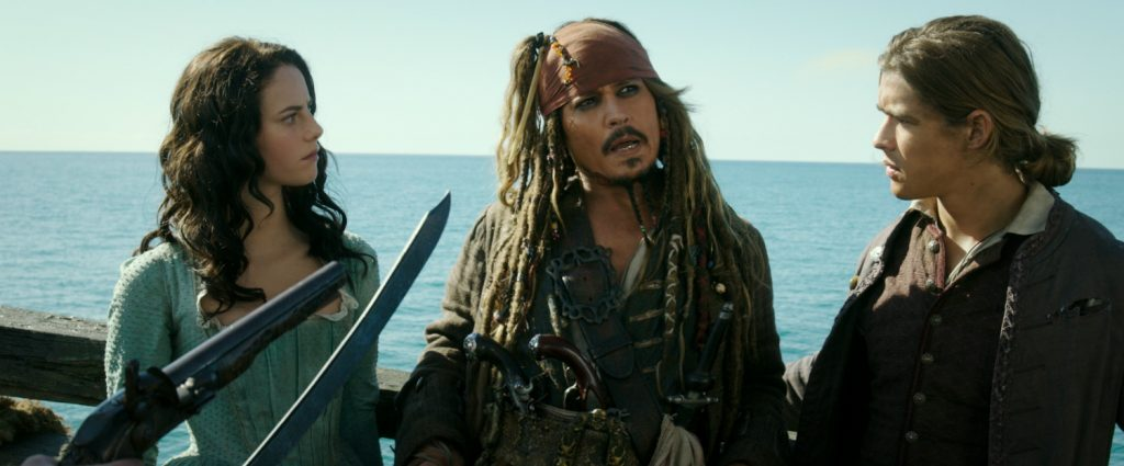 """PIRATES OF THE CARIBBEAN: DEAD MEN TELL NO TALES"" The villainous Captain Salazar (Javier Bardem) pursues Jack Sparrow (Johnny Depp) as he searches for the trident used by Poseidon Pictured L to R: Carina Smyth (Kaya Scodelario), Captain Jack Sparrow (Johnny Depp) and Henry Turner (Brenton Thwaites) Ph: Film Frame © Disney Enterprises, Inc. All Rights Reserved."