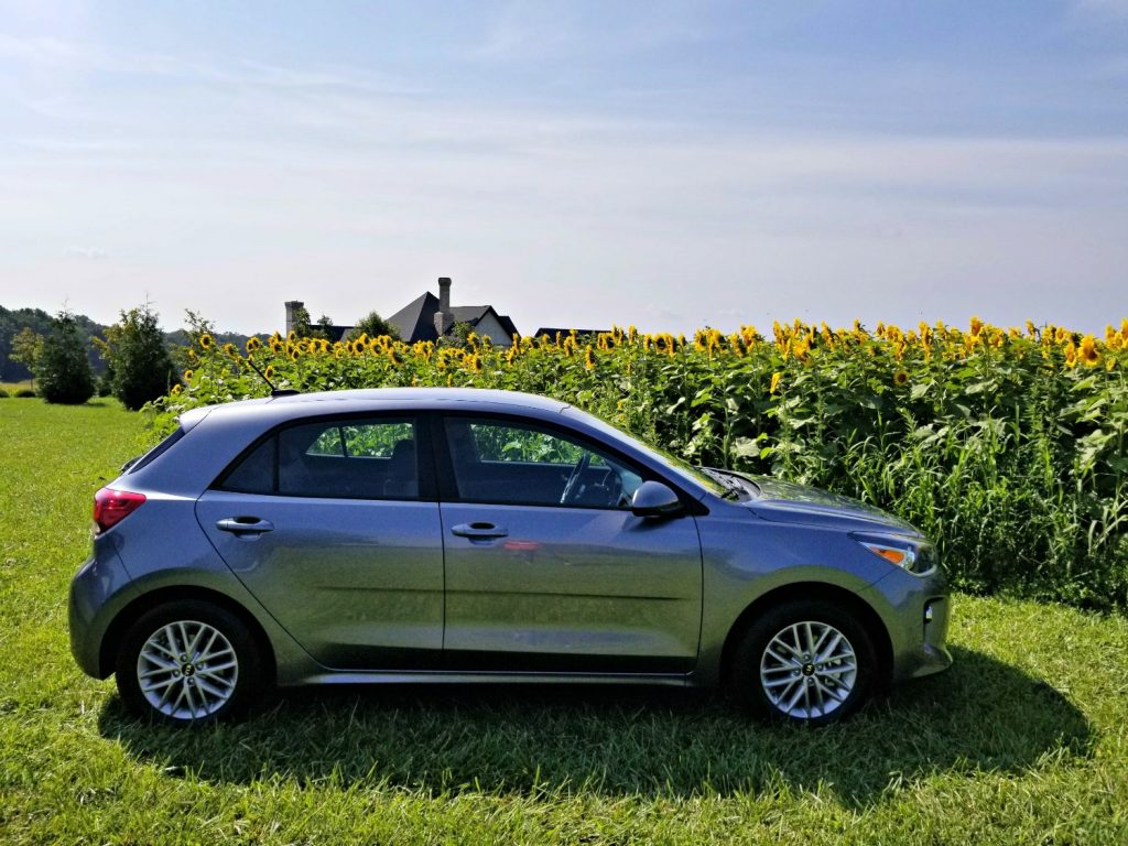 2018 Kia Rio in front of the sunflower patch R