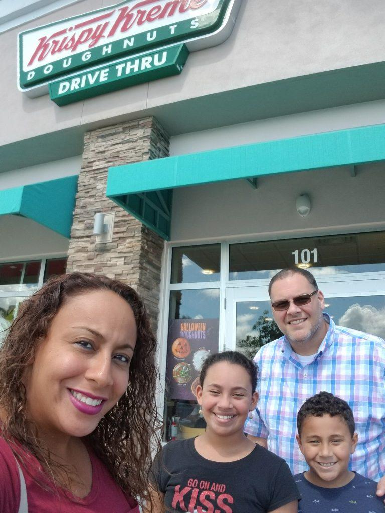 Family pic outside Krispy Kreme
