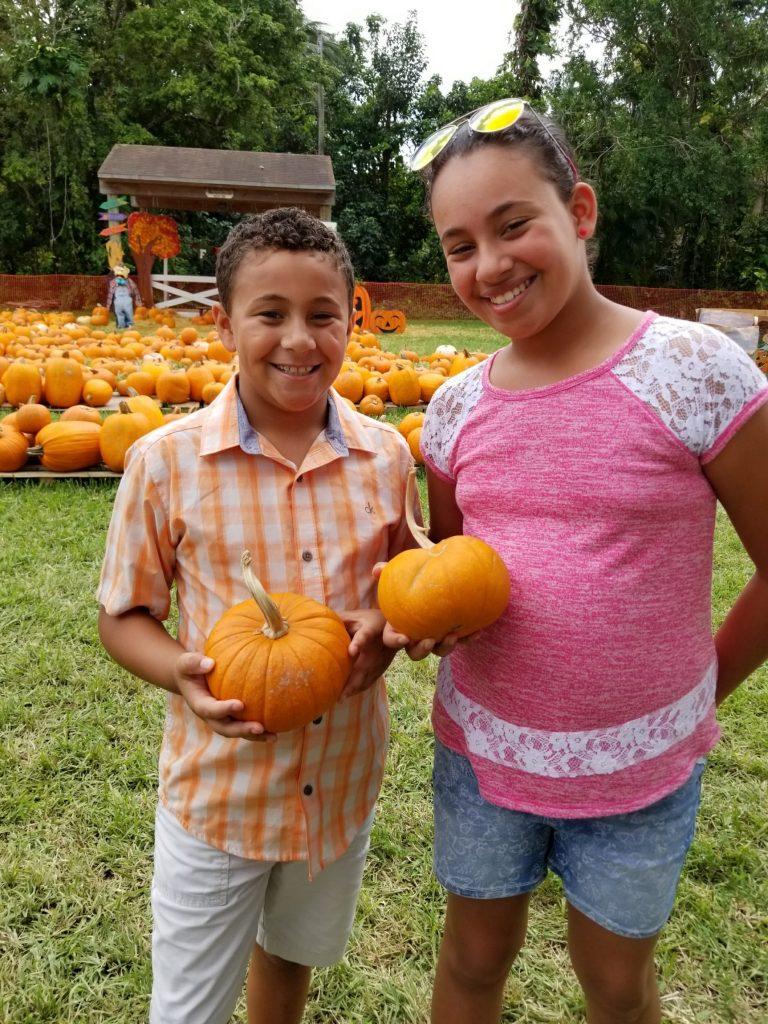 Kiddos and their pumpkins at Pumpkin Patch 2017