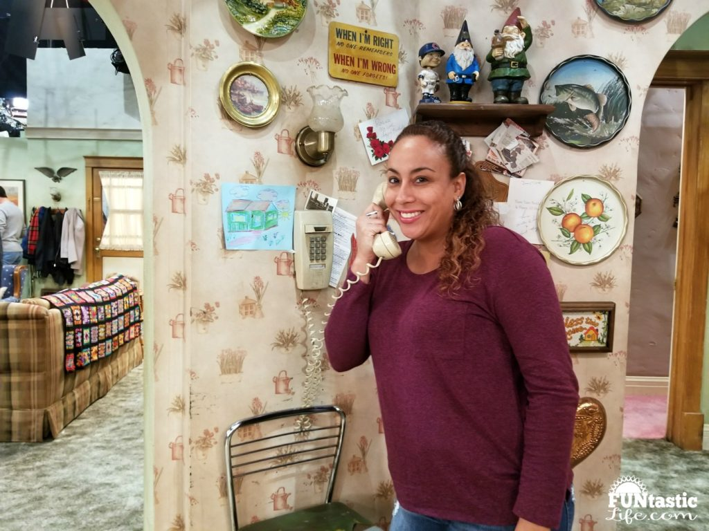 Leanette Fernandez on the phone on Roseanne Set