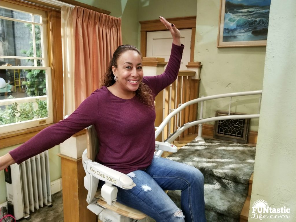 Leanette Fernandez on the stair escalator chair on Roseanne Set