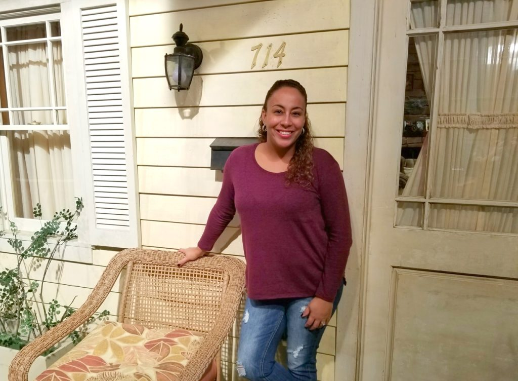 Leanette at front door of Roseanne Set
