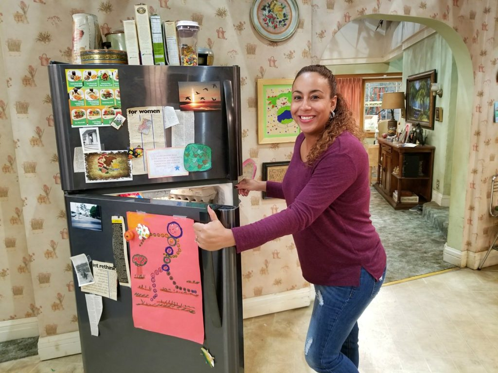 Leanette looking through the Roseanne Set Refrigerator