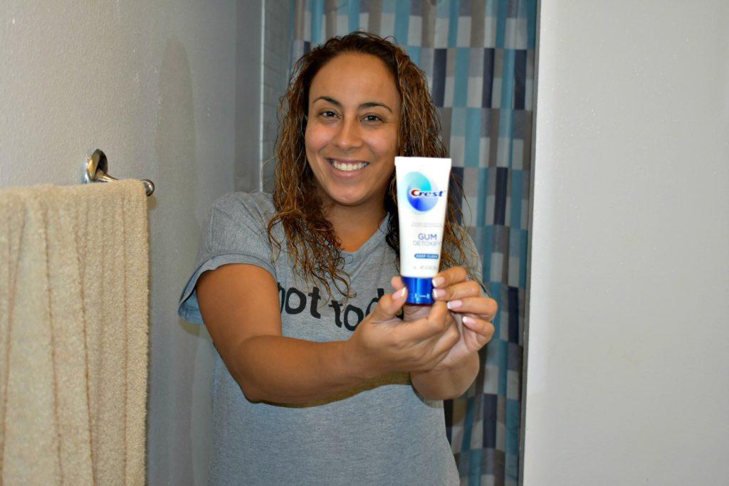 Woman holding Crest Gum Detoxify