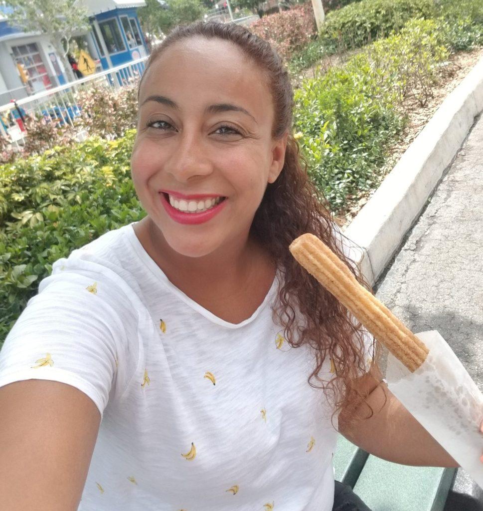 Lady eating a churro