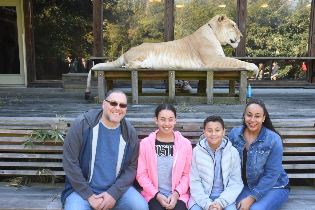 family in front of a Liger