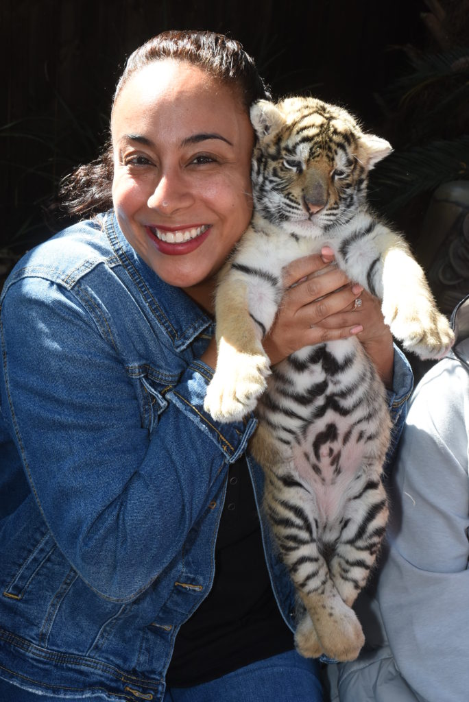woman with a tiger cub