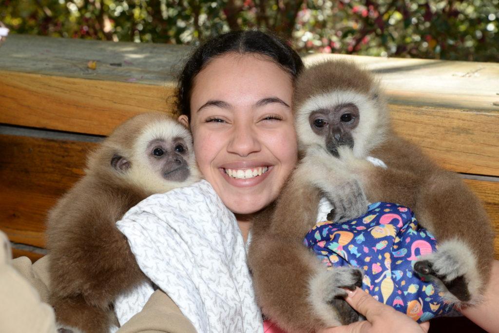 girl with 2 monkeys