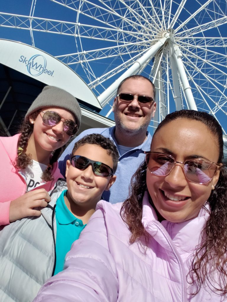 Family in front of SkyWheel