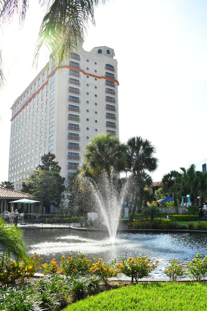 Hotel with a fountain in front