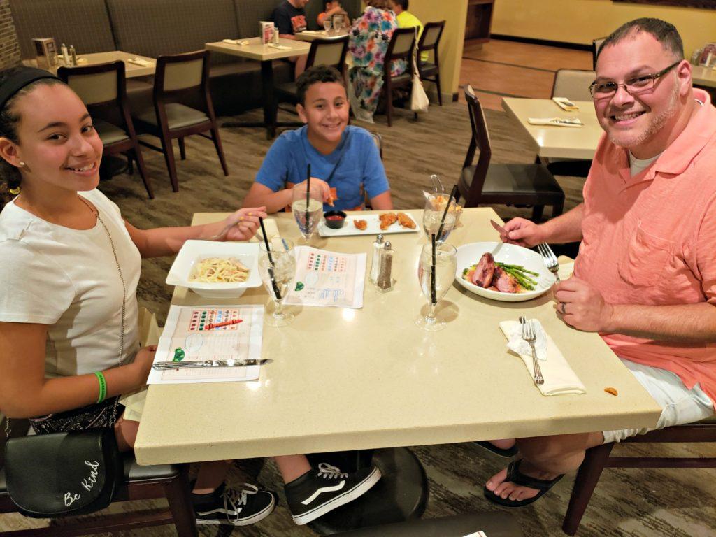 family eating dinner at a restaurant