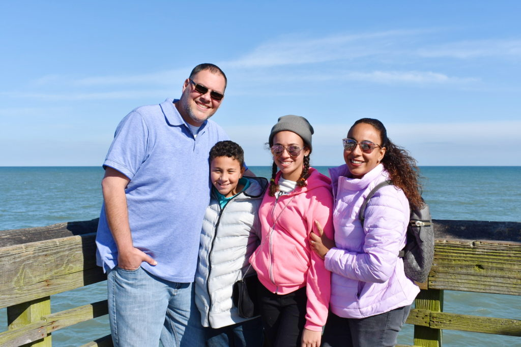 Family standing on a pier in Myrtle Beach
