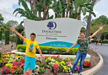 kids in front of a hotel entrance sign