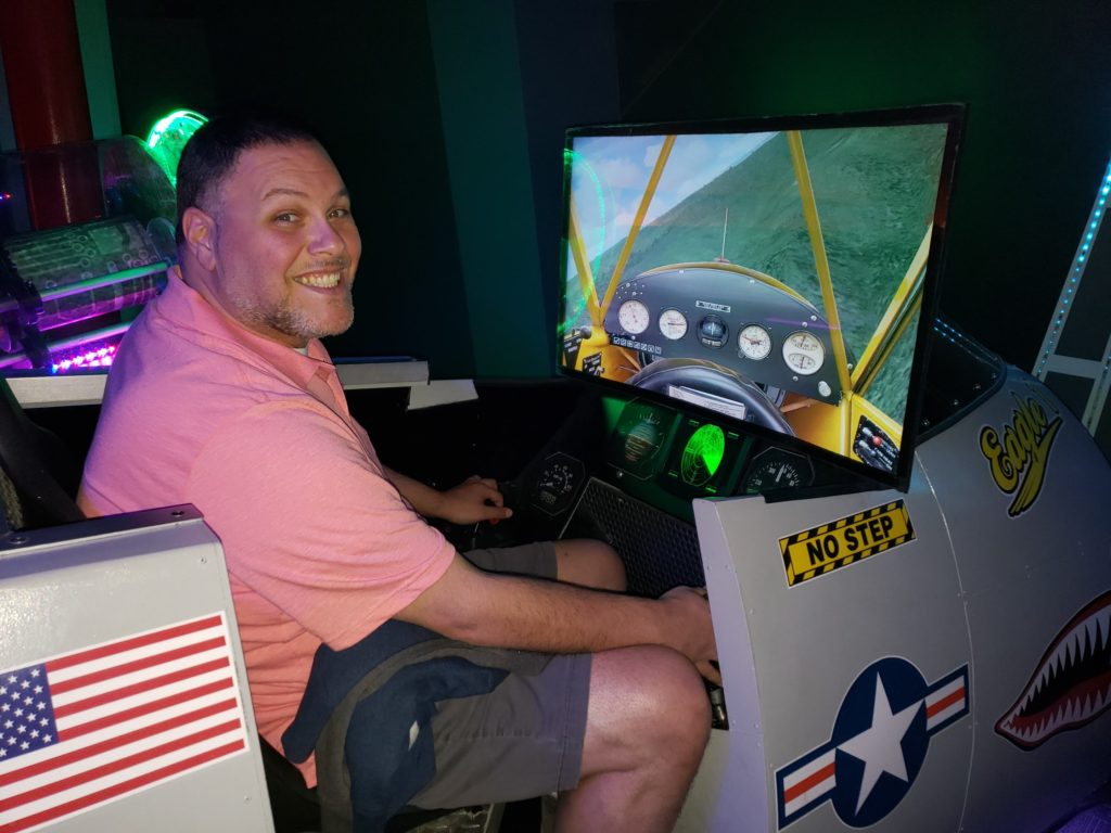 Adult man sitting in a fighyer jet