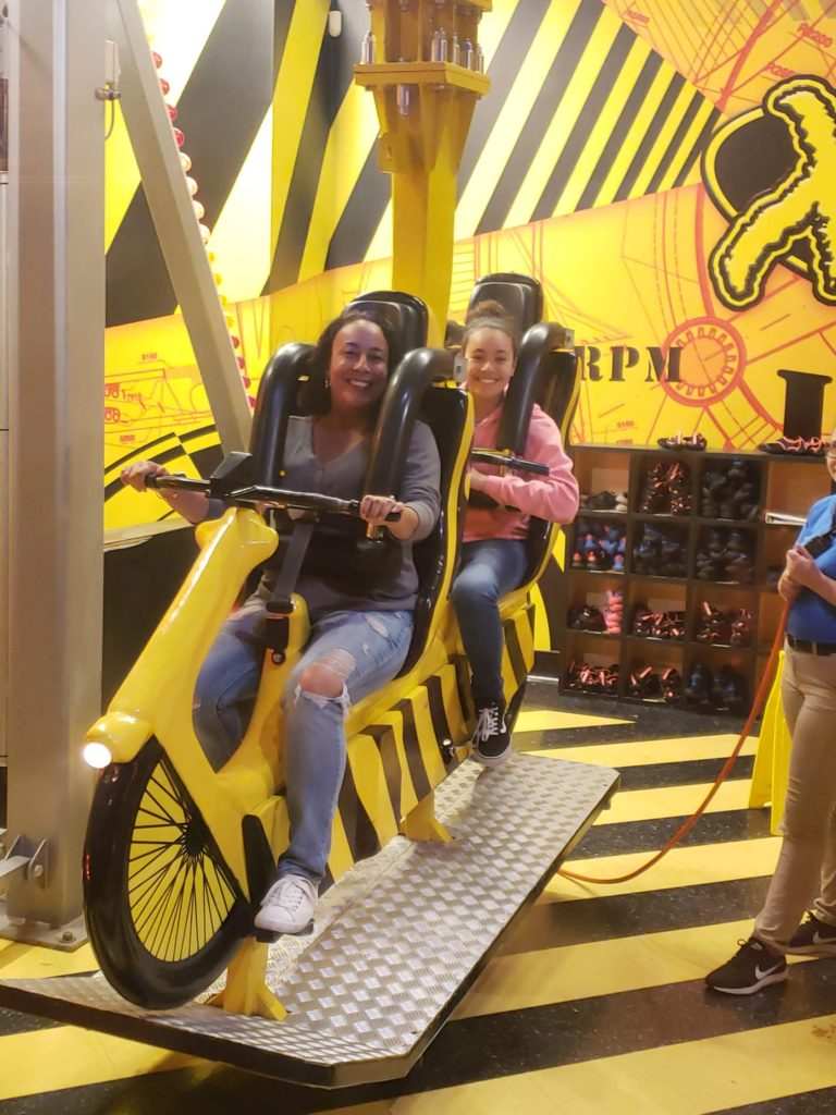 Mom and daughter on a ride at WonderWorks Myrtle Beach