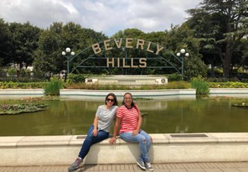 2 women in front of the Beverly Hills Sign