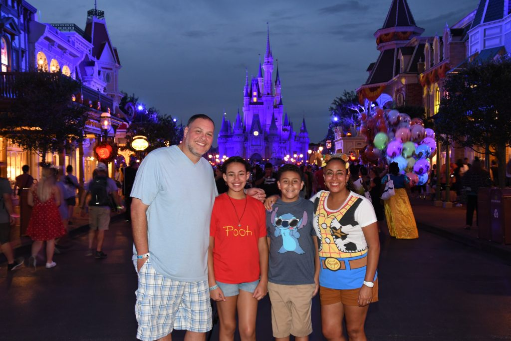 Family in front of Magic Kingdom Castle