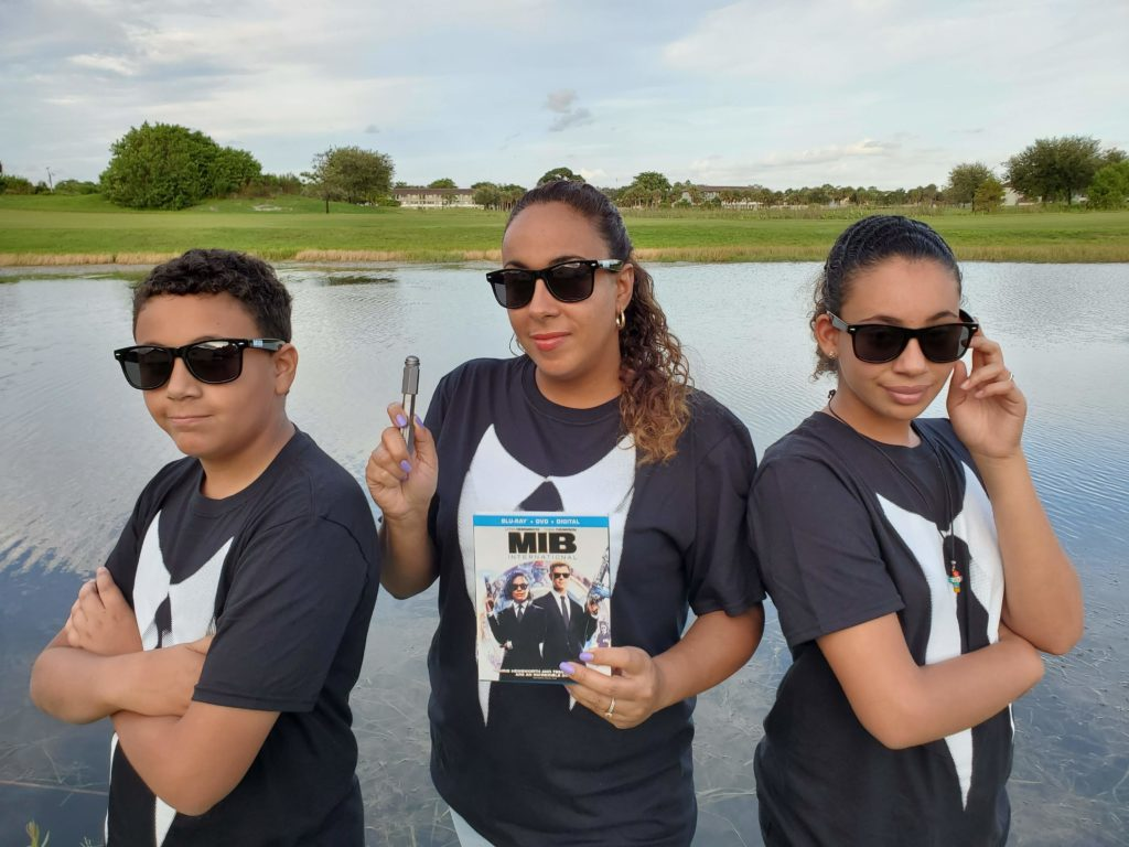 Family dressed as Men In Black Agents