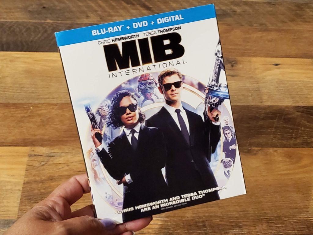 Lady holding a Men in Black International DVD