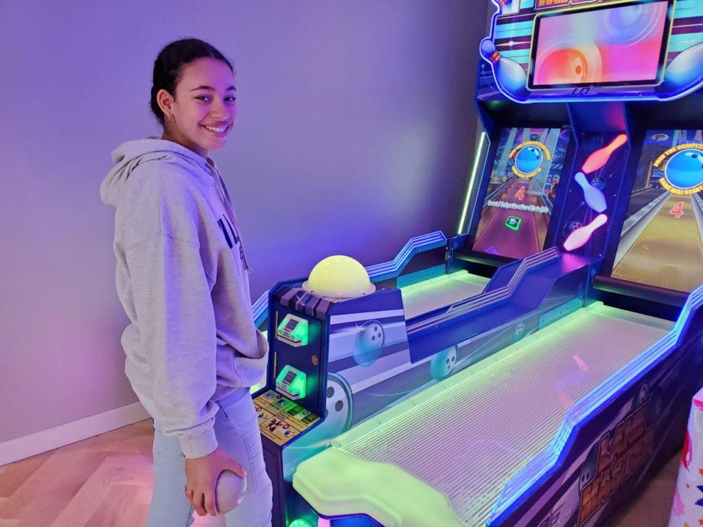 girl playing arcade games