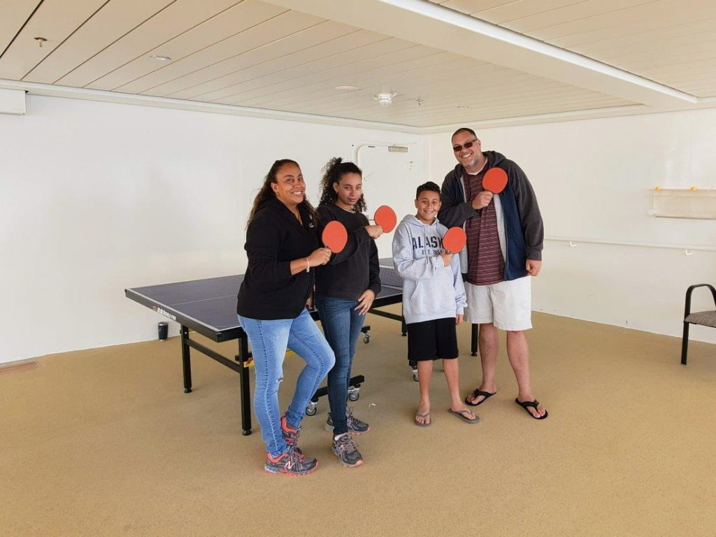 family playing ping pong