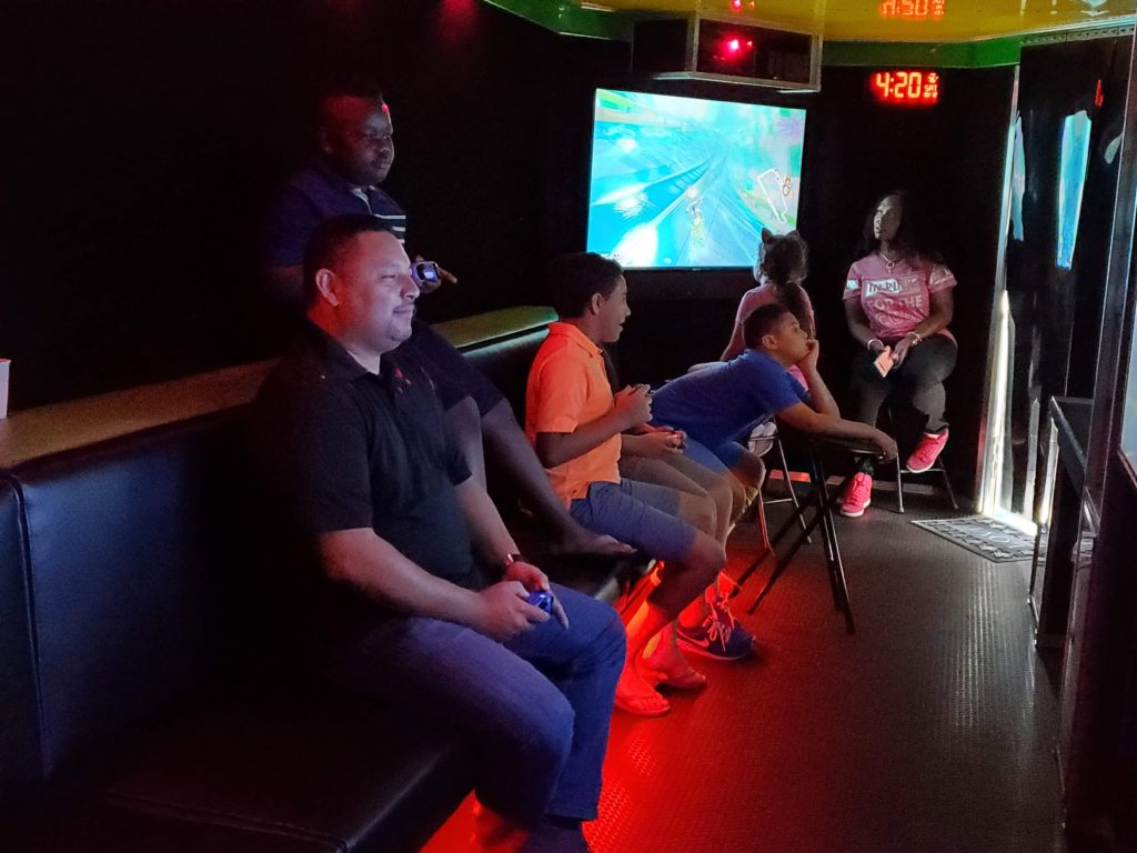 adult and children in a game truck