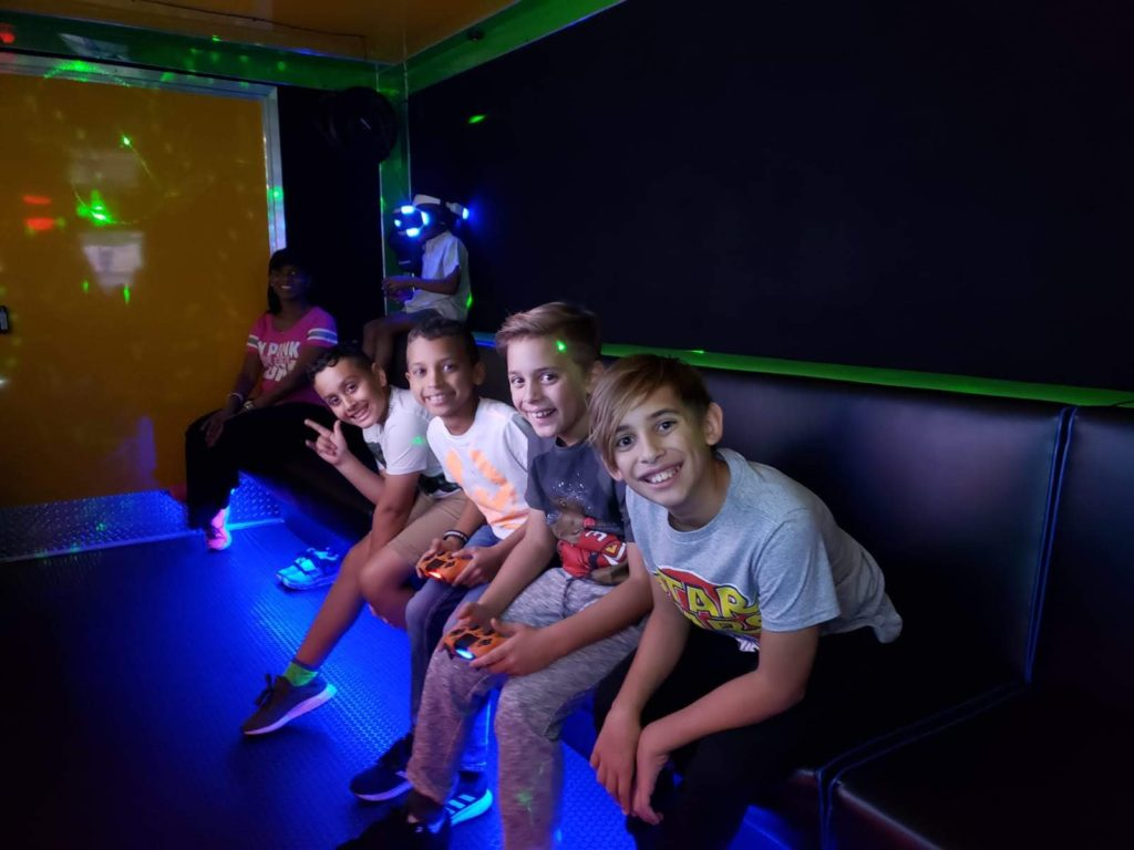 Boys smiling inside a game truck