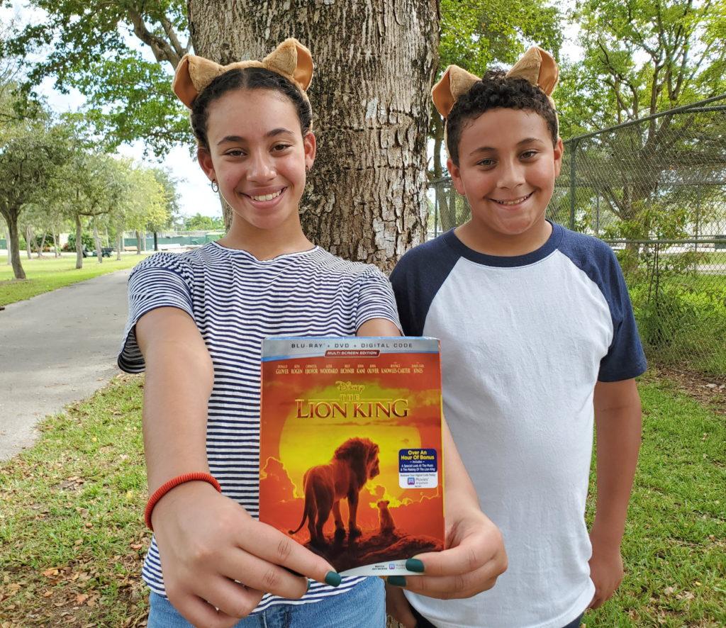Kids holding up a DVD