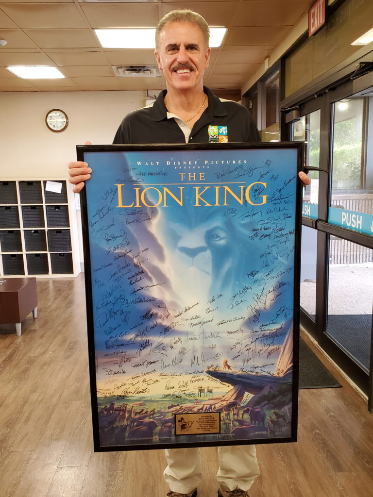 Man holding Lion King Poster
