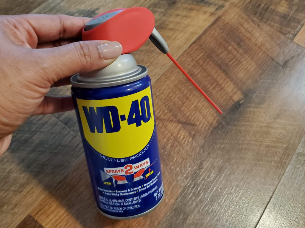 WD-40 can on a wood floor
