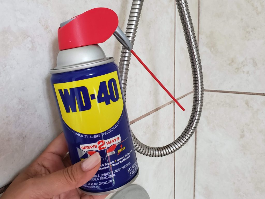 WD-40 can in a shower