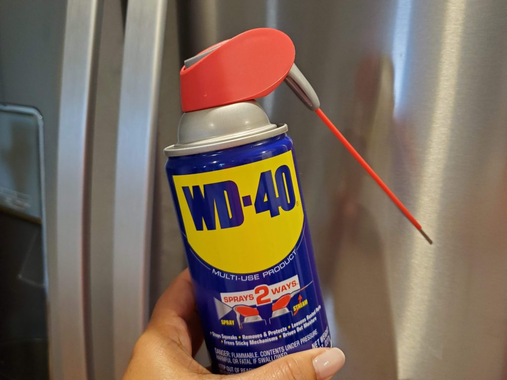 WD-40 can by a refrigerator