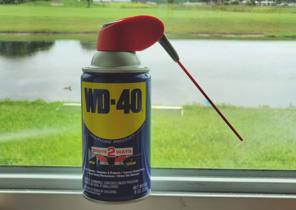 WD-40 can by a window