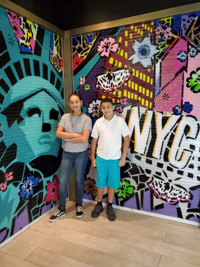 Kids in front of NYC Artwork