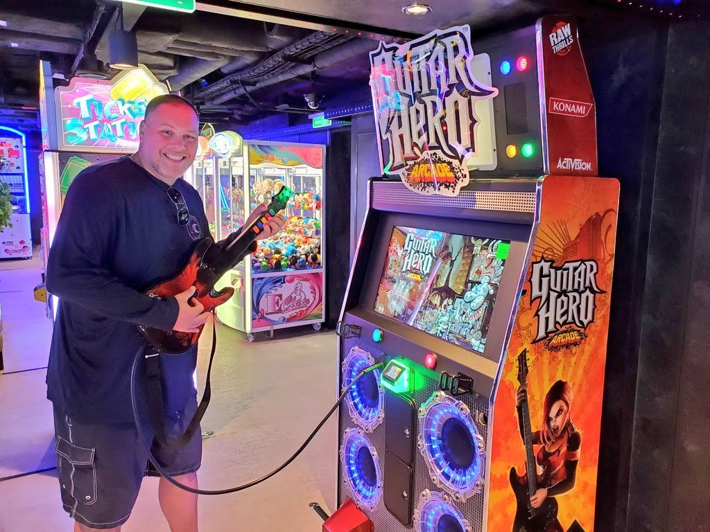 man playing arcade games