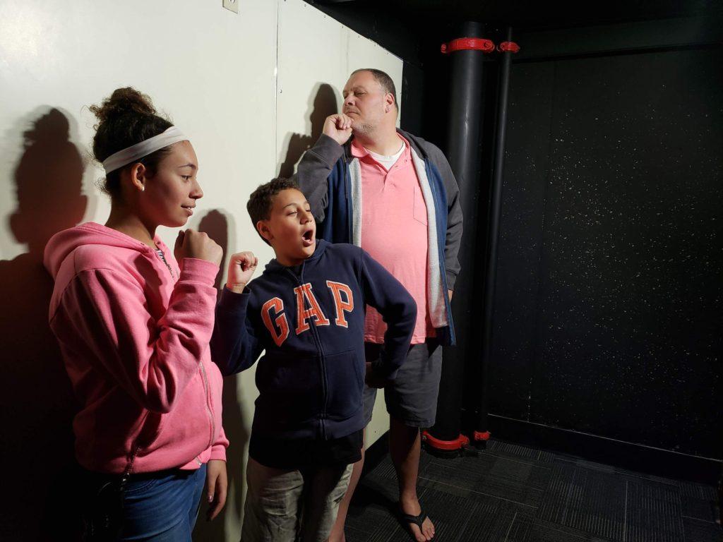 family posing at Wonder Works