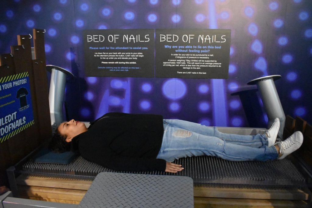 Lady on a bed of nails