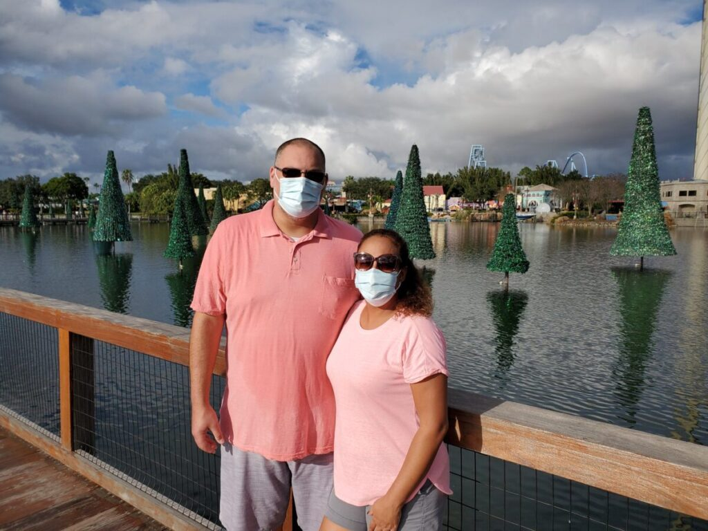 Couple in front of Christmas Trees at SeaWorld