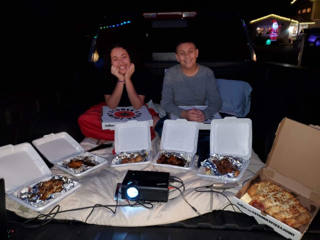 eating pizza on a truck